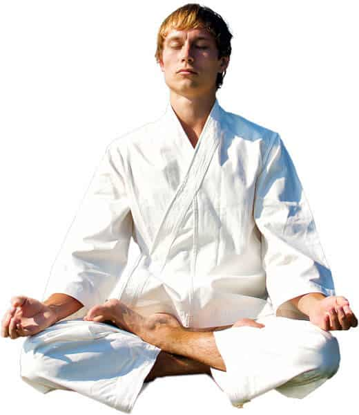 Martial Arts Lessons for Adults in Zephyrhills FL - Young Man Thinking and Meditating in White
