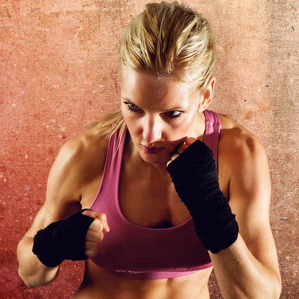 Mixed Martial Arts Lessons for Adults in Zephyrhills FL - Lady Kickboxing Focused Background