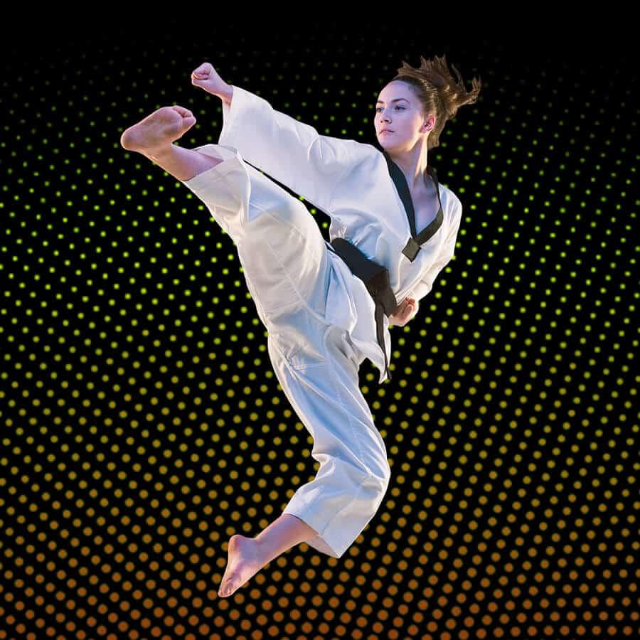 Martial Arts Lessons for Adults in Zephyrhills FL - Girl Black Belt Jumping High Kick