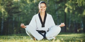 Martial Arts Lessons for Adults in Zephyrhills FL - Happy Woman Meditated Sitting Background