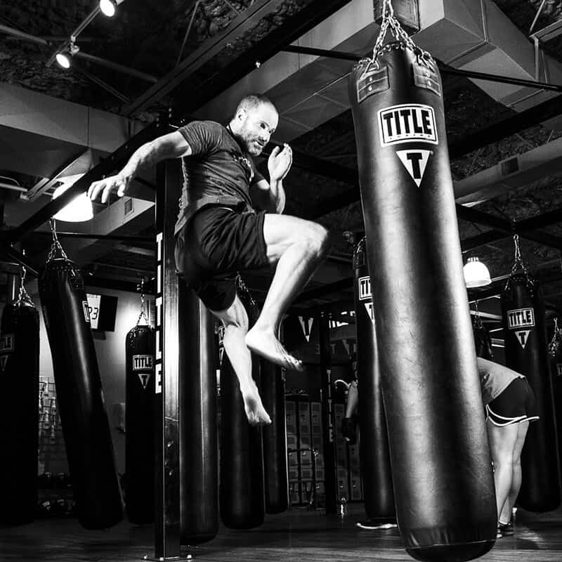 Mixed Martial Arts Lessons for Adults in Zephyrhills FL - Flying Knee Black and White MMA